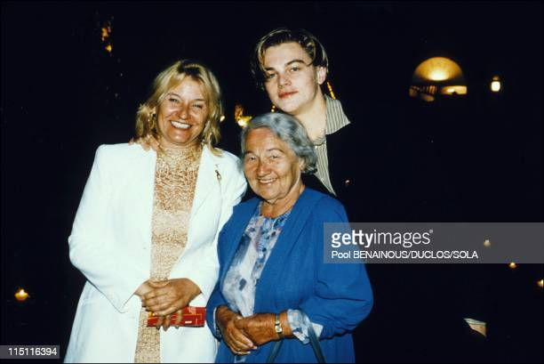 Moulin de Mougins Amfar benefits eveningdinner in Cannes France on May 16 1996 Leonardo di Caprio with his mother and his grand mother