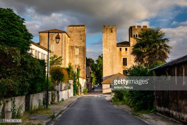 moulin des tours - fortified mill in barbaste, france, at sunset - anton petrus stock pictures, royalty-free photos & images