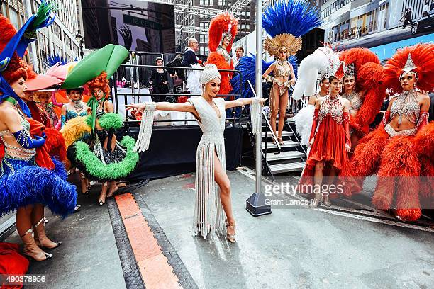 Moulin Rouge dancers model in a fashion show at the Best Of France in Times Square on September 27 2015 in New York City This stop was part of Moulin...
