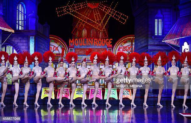 Moulin Rouge dancers perform on November 7 2014 in a bid to break the record of the simultaneous demigrand rond de jambe cancan kicks by a single...
