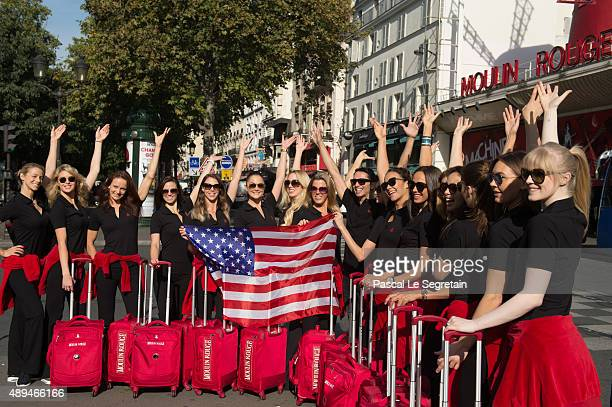 Moulin Rouge dancers pose with the American flag as they prepare to leave iconic Moulin for an historic trip to New York City on September 21 2015 in...