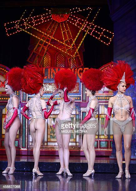 Moulin Rouge dancers wait before performing on November 7 2014 in their bid to break the record of the most consecutive high kicks by a single chorus...