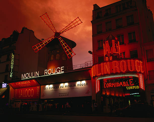 Moulin Rouge nightclub in the Pigalle district, founded in 1889, known for its scantily clad chorus girls.