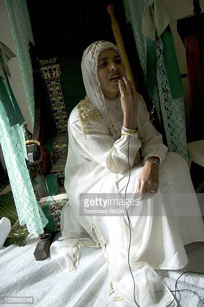 Moulood an Nabi in Cape Town South Africa on February 21 2010 One of the women that visited the mecca pray speaking in a microphone The celebration...