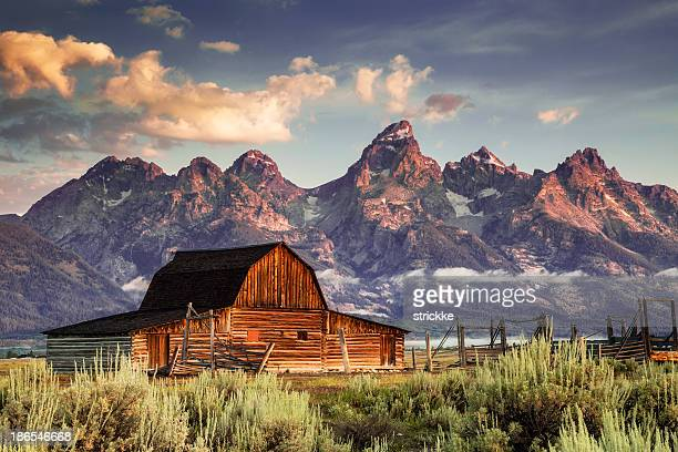 moulton barn and tetons in morning light - jackson hole stock pictures, royalty-free photos & images