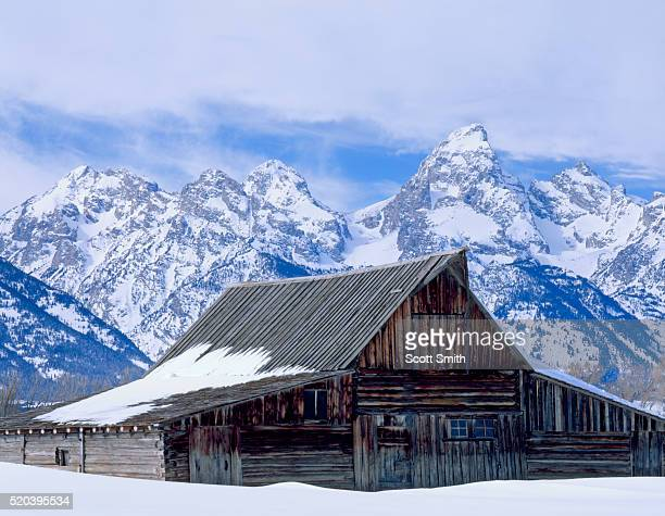 moulton barn below the teton range in winter - jackson hole stock pictures, royalty-free photos & images