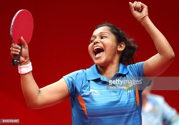 Mouma Das of India celebrates winning as she competes against TinTin Ho of England in the women's singles round of 16 during Table Tennis on day...