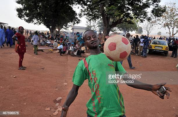 Moumine a 16 yearold muslim juggles with a ball at Bangui's disused air base on February 7 2014 Moumine who has no money nor identity documents...