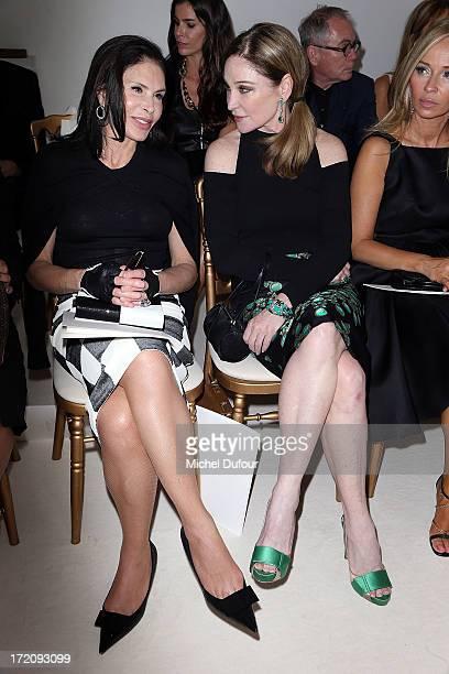 Mouna Ayoub and Becca Cason Thrash attend the Giambattista Valli show as part of Paris Fashion Week HauteCouture Fall/Winter 20132014 on July 1 2013...