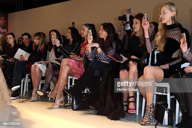 Mouna Ayoub Natacha Andrews guest Sara Brajovic and Tatiana Dyagileva attend the Zuhair Murad show as part of Paris Fashion Week Haute Couture...