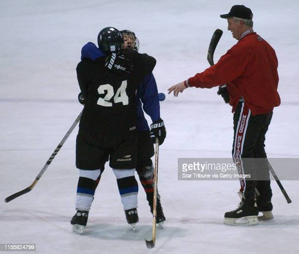 Mound Mn Weds Dec 10 2003Kerry Engel and Linda Dreyer hug as coach Mike Curti drops the puck to start play in a hockey game during Curti's clinic for...