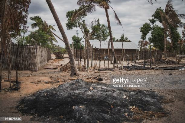 Mound of ashes is seen in the recently attacked village of Aldeia da Paz outside Macomia, on August 24, 2019. - On August 1st, the inhabitants of...