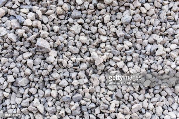 mound of granite gravel, stones, crushed stone close-up. rough seamless texture, construction material background. - gravel stock pictures, royalty-free photos & images