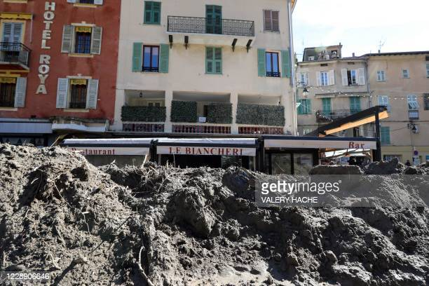 Mound of mud covers a main street following heavy rains and floods that hit Breil-sur-Roya, a French village close to the Italian border, where...