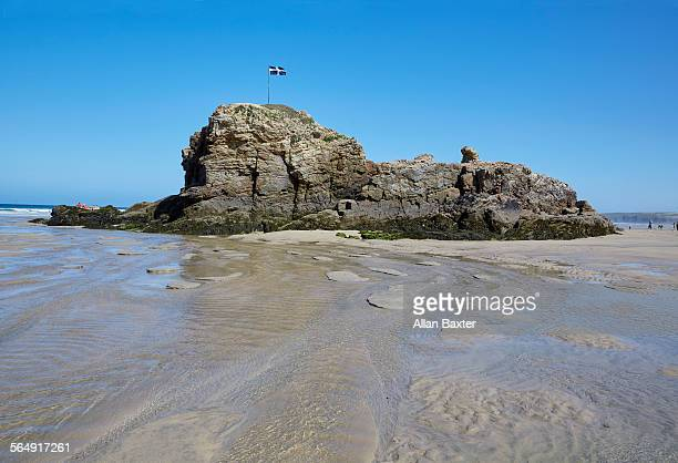 mound on perranporth beach with cornish flag - cornish flag stock pictures, royalty-free photos & images