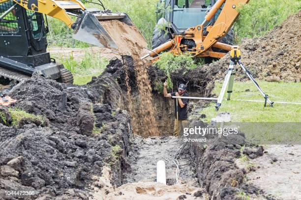 mound septic system installation - trench stock pictures, royalty-free photos & images