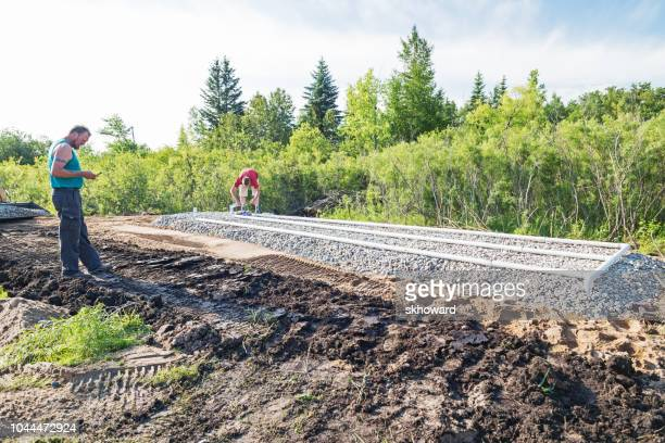 mound septic system installation - septic tank stock photos and pictures