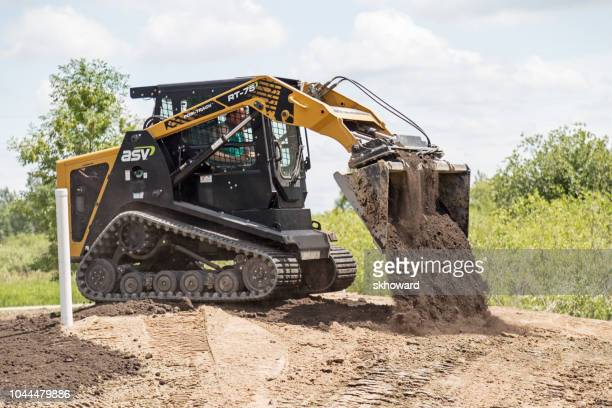 mound septic system installation - bobcat stock pictures, royalty-free photos & images