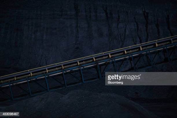 Mounds of coal mined from a Harlan County coal mine stand along the Cumberland River in Coldiron Kentucky US on Wednesday Nov 6 2013 In 2011 coal was...