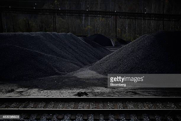 Mounds of coal mined from a Harlan County strip mine stand along Route 119 in Totz Kentucky US on Thursday Nov 7 2013 In 2011 coal was used to...