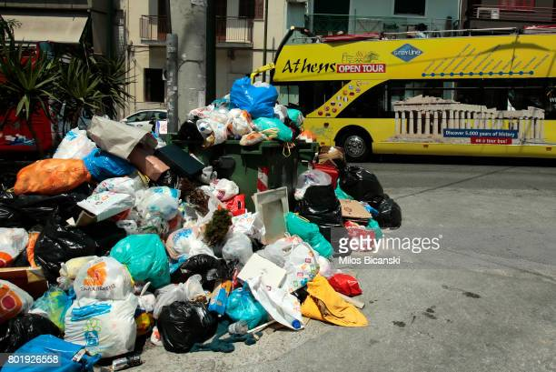 Mounds of rubbish fester in soaring temperatures because of municipal workers' strike on June 27 2017 in Athens Greece With rubbish piling up in...