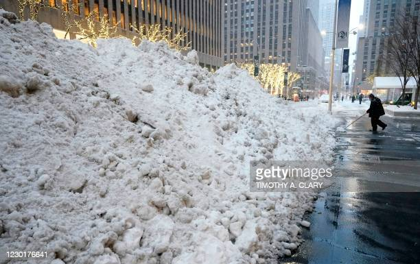 Mounds of snow are seen on Sixth Avenue on December 17, 2020 in New York, the morning after a powerful winter storm hit the US northeastern states. -...