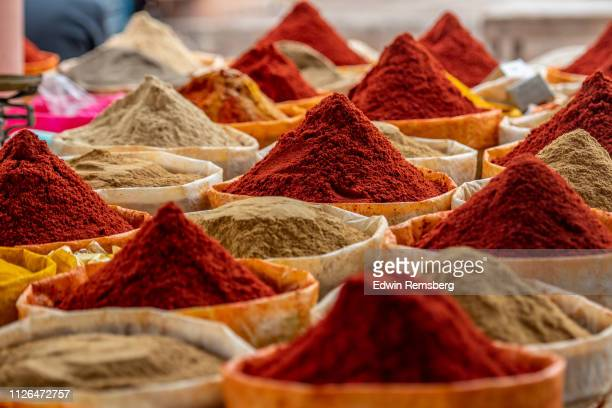 mounds of spices - spice stock pictures, royalty-free photos & images