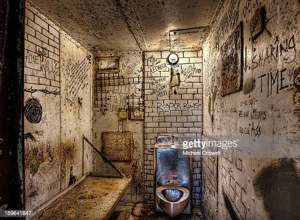 CONTENT] Moundsville West Virginia West Virginia State Penitentiary Cell Block with Graffiti and drawings on the Cell Block walls showing life inside...
