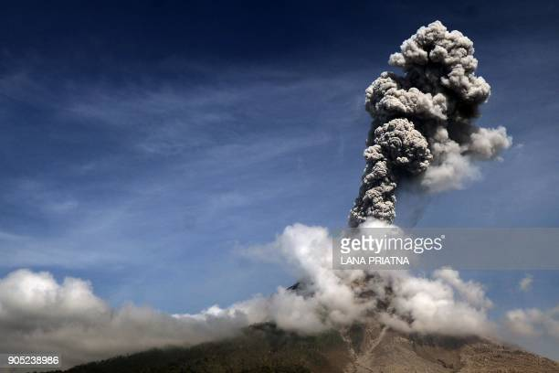TOPSHOT Moung Sinabung volcano spews thick smoke in Karo North Sumatra on January 15 2018 Mount Sinabung roared back to life in 2010 for the first...
