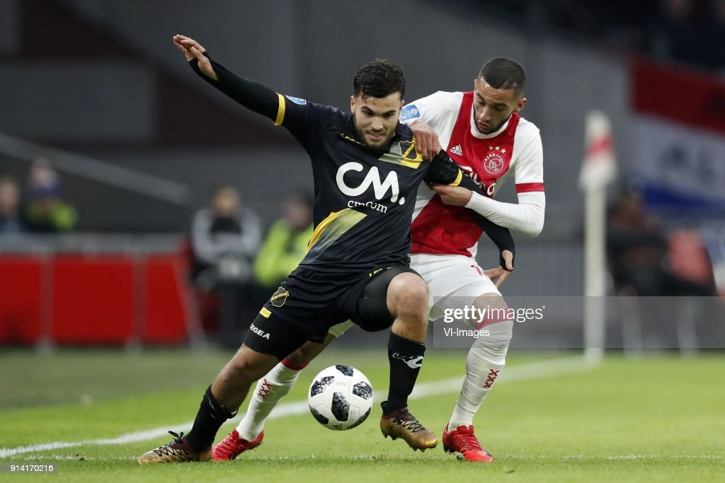 Mounir El Allouchi of NAC Breda, Hakim Ziyech of Ajax during the Dutch Eredivisie match between Ajax Amsterdam and NAC Breda at the Amsterdam Arena on February 04, 2018 in Amsterdam, The Netherlands
