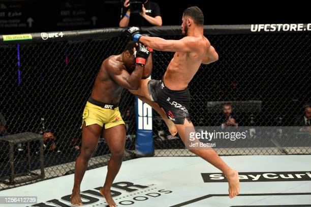 Mounir Lazzez of Tunisia throws a flying knee against Abdul Razak Alhassan of Ghana in their welterweight fight during the UFC Fight Night event...