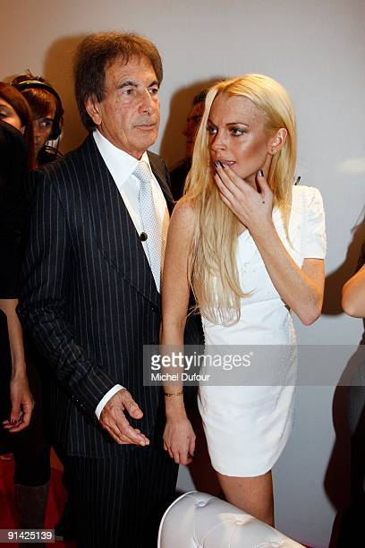 Mounir Moufarrige and Lindsay Lohan attend Emmanuel Ungaro Pret a Porter during Paris Womenswear Fashion Week Spring/Summer 2010 at Le Carrousel du...