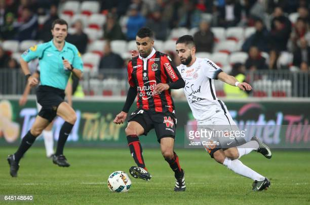 Mounir Obbadi of Nice and Ryad Boudebouz of Montpellier in action during the French Ligue 1 match between OGC Nice and Monptellier Herault SC at...