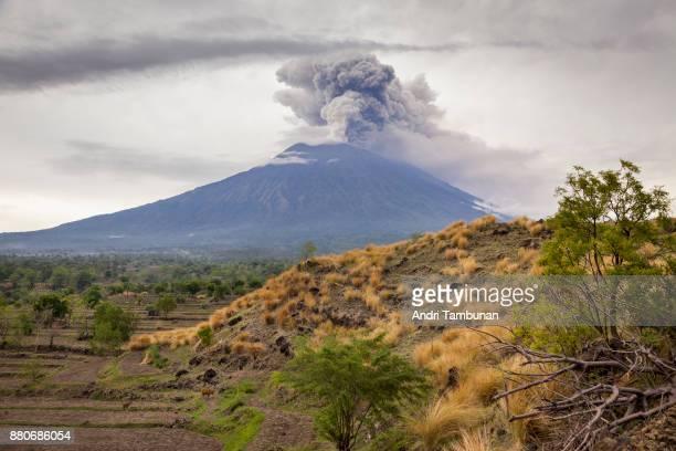 KARANGASEM BALI INDONESIA NOVEMBER 28 Mount Agung is seen spewing heavy volcanic ash on November 28 2017 in Karangasem Island of Bali Indonesia...