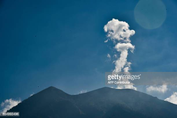 Mount Agung volcano spews smoke to the air as seen from Karangasem on paradise island of Bali on September 28 2017 The last time Bali's Mount Agung...