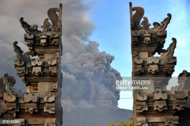 TOPSHOT Mount Agung's eruption is seen between Balinese temple at Kubu subdistrict in Karangasem Regency on Indonesia's resort island of Bali on...