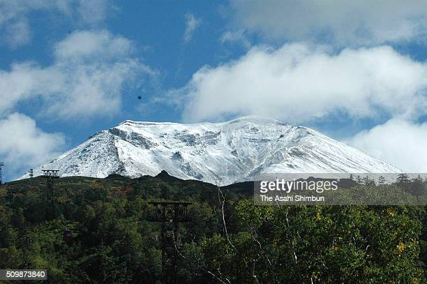 Mount Asahidake is covered with the first snow of the season on September 21 2005 in Higashikawa Hokkaido Japan