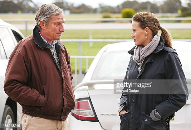 Mount Athos trainer Luca Cumani speaks to Francesca Cumani after the horse galloped during trackwork at Werribee Racecourse on October 30, 2013 in...