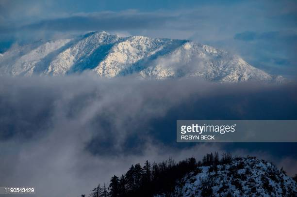 Mount Baldy is covered in snow in the Angeles National Forest north of Los Angeles California on December 26 2019 after a cold winter storm brought...