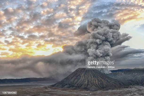 mount bromo during eruption - mt bromo stock photos and pictures