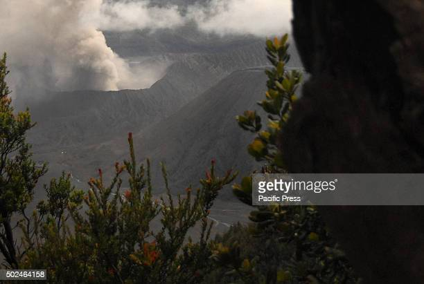Mount Bromo spews volcanic materials into the air as seen from, view points Penanjakan, Tosari, Pasuruan, East Java. The status of Mount Bromo is...