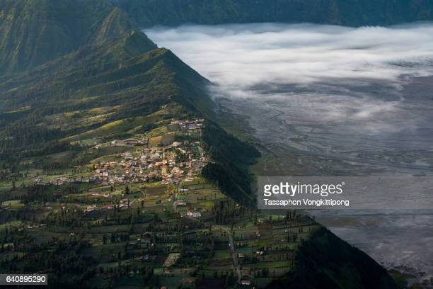 Mount Bromo volcanic plateau village morning fog