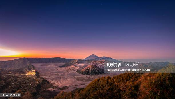 mount bromo volcano (gunung bromo) at sunrise with colorful sky - mt bromo stock pictures, royalty-free photos & images