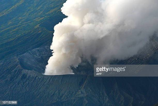 Mount Bromo volcano emits a column of steam from its crater as seen from a viewing point in the Pasuruan district of East Java province on November...
