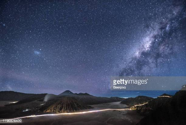 mount bromo volcano on night sky with milky way in bromo tengger semeru national park, east java, indonesia. - bromo crater stock pictures, royalty-free photos & images