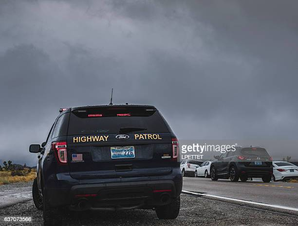 mount charleston winter storm police road block - mt charleston stock photos and pictures