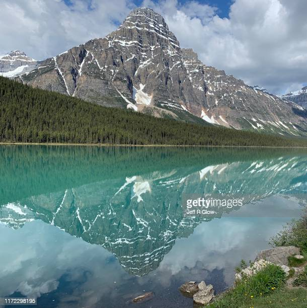 mount chepren reflection in the spring - snowcapped mountain stock pictures, royalty-free photos & images