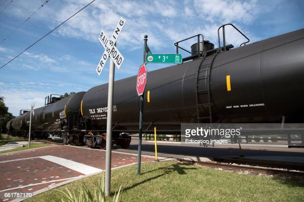 Mount Dora Florida USA Railroad freight train passing over unmanned crossing