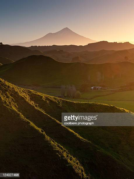 Mount Egmont with hilly countryside in vertical