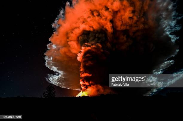 Mount Etna erupts in the night with lava fountains one kilometer high and a column of ash over 10 km high heading towards nearby Tyrrhenian on...